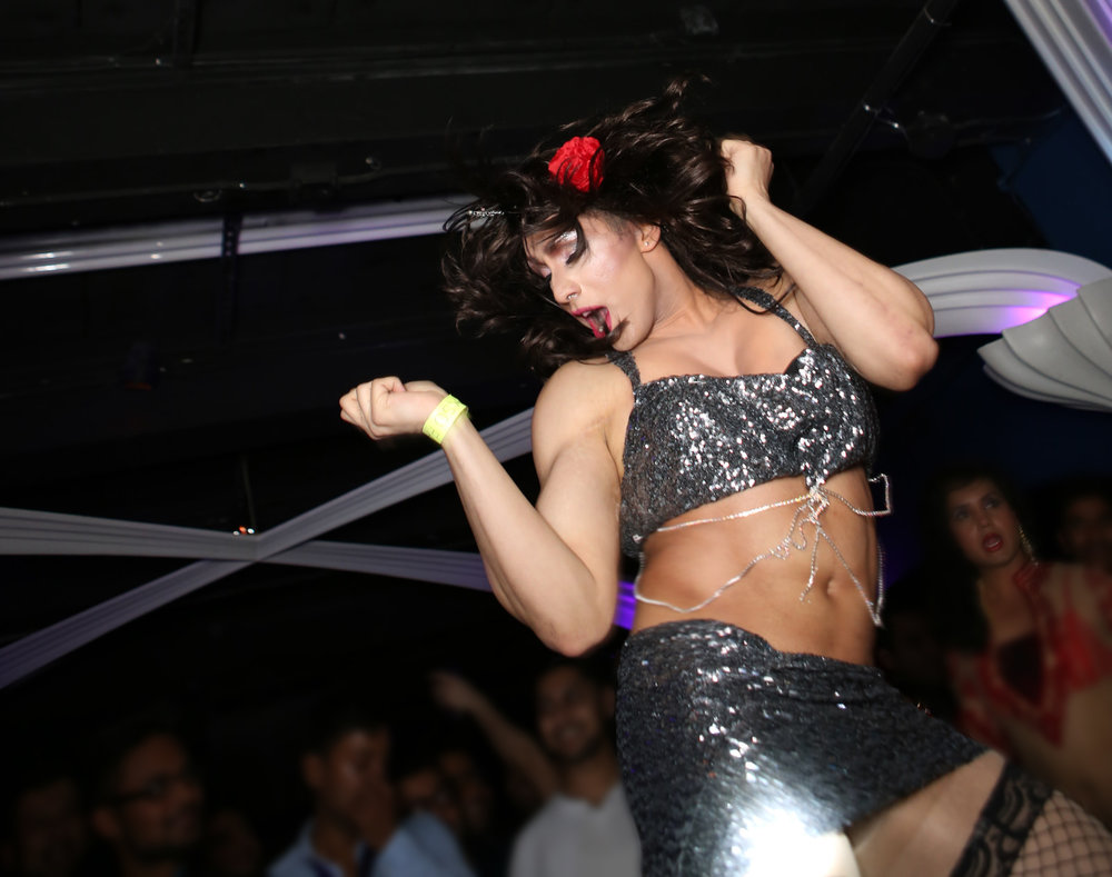 Tara Ryst - made her debut in 2014 and is based on NYC, often performing at Sholay Event's Desilicious parties in the city.  In 2015, Tara Ryst also performed during Toronto Pride in a show featuring that year's International Grand Marshal and Bollywood Actress Celina Jaitly, as well as RuPaul's Drag Race season 3 winner Raja.  A lifelong fan of Bollywood Icon Sridevi, Tara Ryst will be performing tonight to a medley of Sridevi's hit songs.
