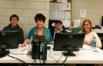 Help Desk Staff Julie Mennel (second from left) and Volunteers