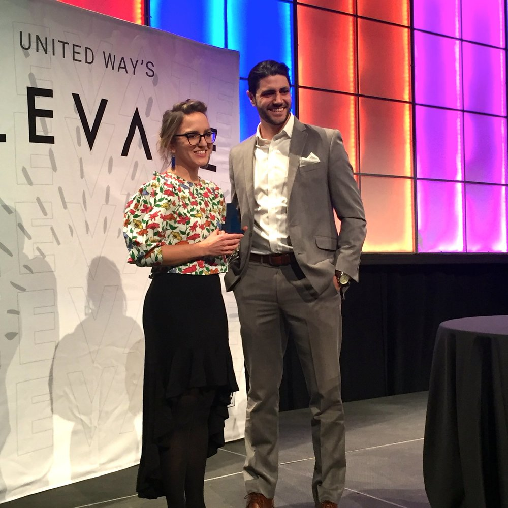 Clinic volunteer Katie Bailey accepting her United Way of Central Indiana ELEVATE award