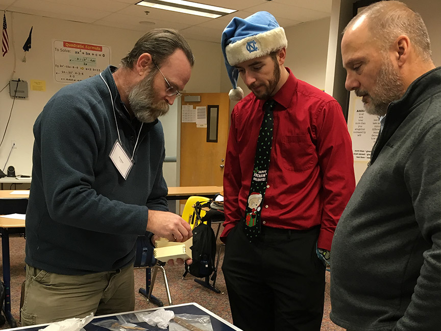 Archaeologist Morgan Blanchard showing artifacts to Kotzebue High School teachers (Dec 2015)
