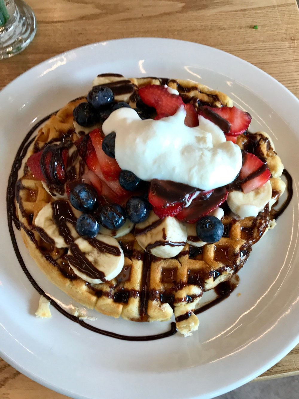 Who can resist these scrumptious waffles topped with banana, seasonal berries, whipped cream and chocolate syrup.   Kid friendly, adult friendly, even dog friendly minus the chocolate syrup.