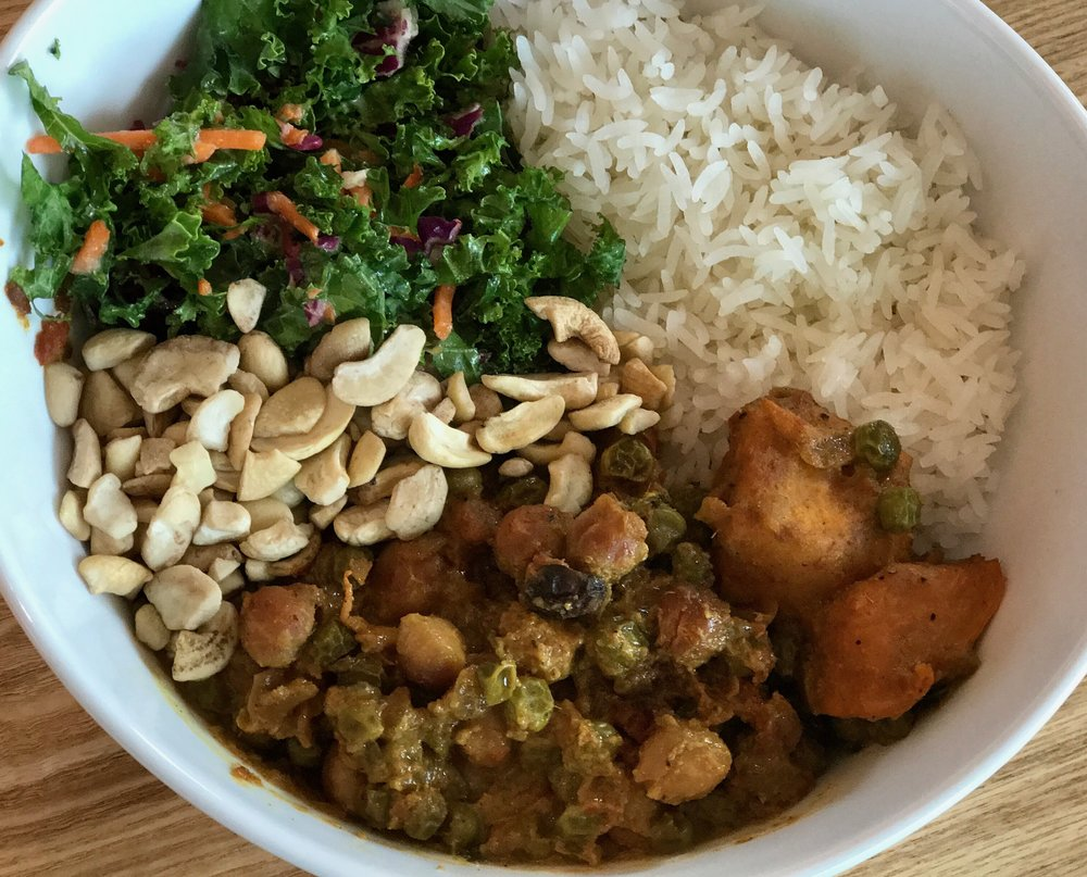 Surprise, surprise...it's 100% VEGAN.  Sweet potato, garbanzo beans, green peas, kale salad, cashews, and jasmine rice.  Chef Mawa's personal favorite.