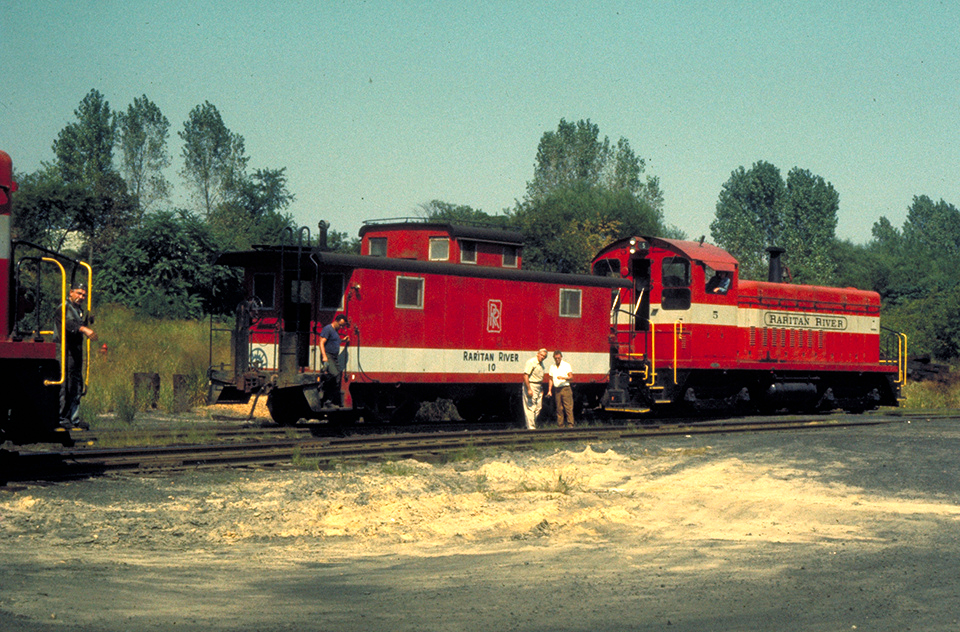 RRRR No. 10 in service with locomotive No. 5, wearing an earlier paint variation with a grey logo. This was later changed to black, and No. 10 was the only RRRR caboose to receive a logo of any sort.  (Charles Belt collection, Rochester & Genesee Valley Railroad Museum)