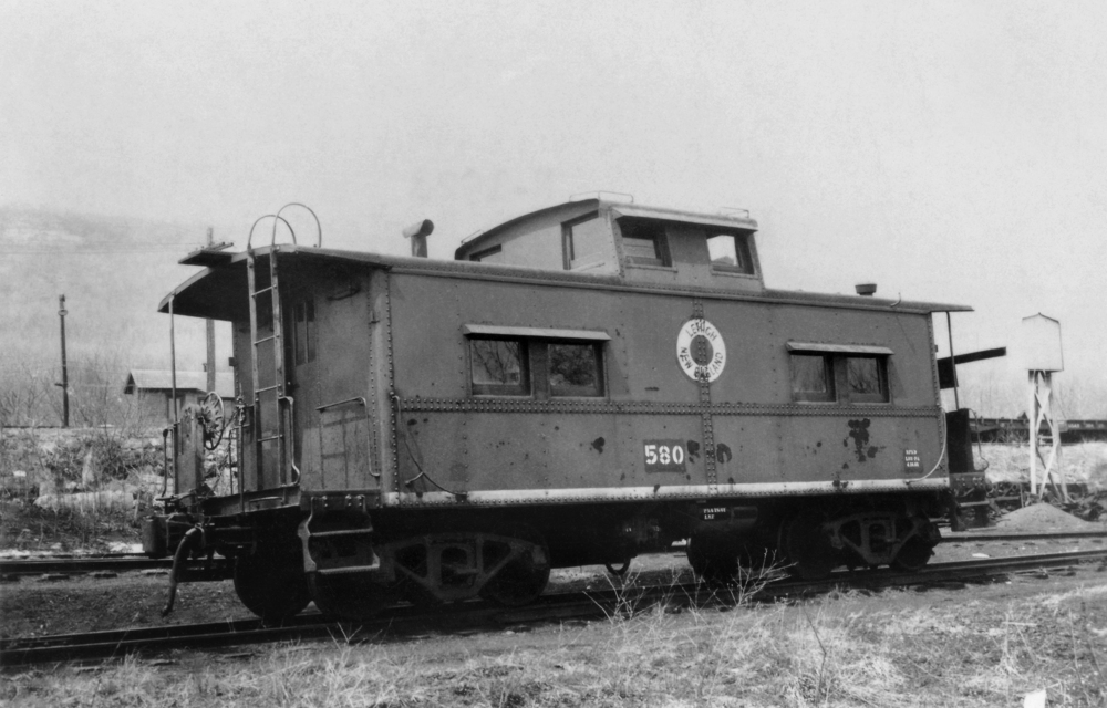 No. 580 in Pen Argyl, PA in 1960, near the end of its service on the L&NE. Note the awnings that have been added over the windows - these awnings would prove useful in identifying the caboose later in life.  (Rudy Garbely collection)