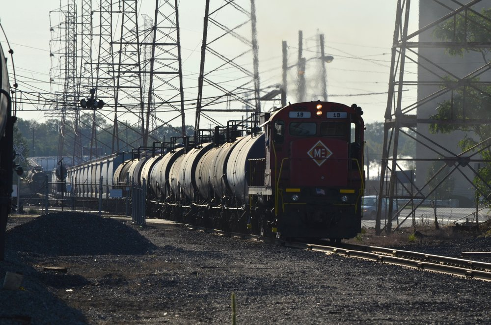 This photo exemplifies the significant power which Alco C-424's possess. At almost 50 years old, No. 19 is seen hauling a long string of freight cars at Bayway Refinery in Linden, NJ on September 12, 2012.  (Mike Del Vecchio photo)