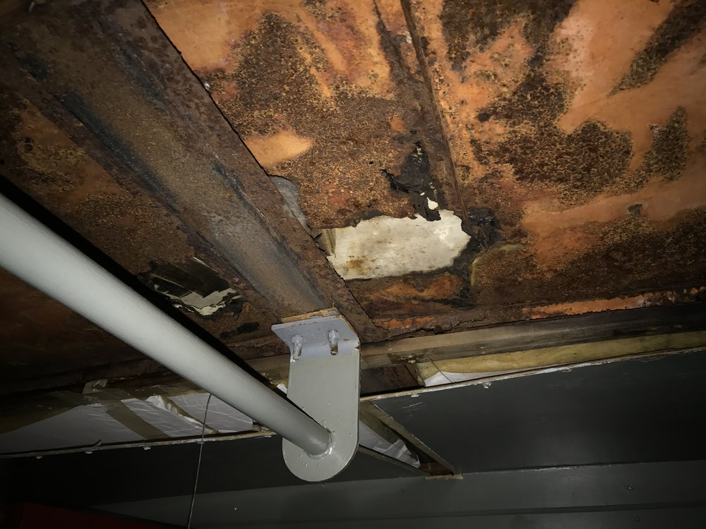 A hole through the ceiling, which was presumably repaired by Conrail, is part of major cause of how water is entering the roof.