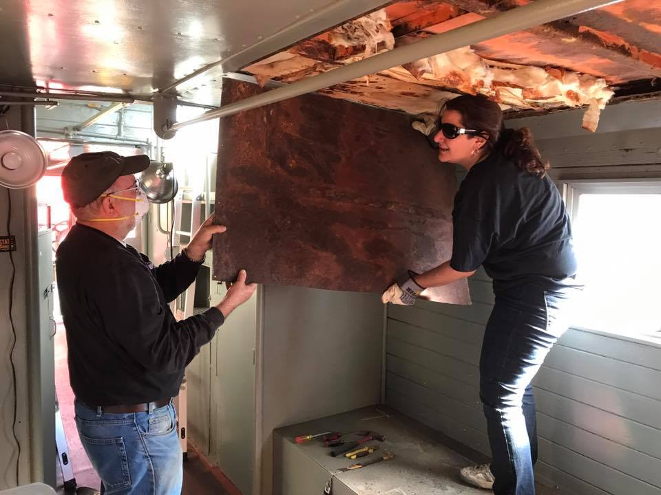 Pete Van Seggern and Laura take down a section of the ceiling.