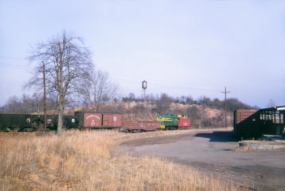 No. 17, paired with Caboose No. 102, pulls a single gondola off of the RV's Rahway River Branch in Kenilworth, NJ on February 13, 1954.  (William S. Young photo, Richard J. King collection)