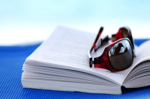 Sunglasses and book on beach chair