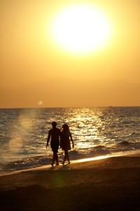 Silhouette of love couple walking on beach