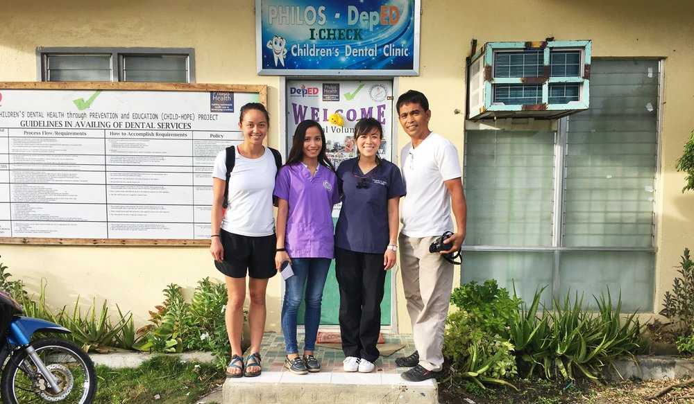 Amber, Dr. Karen, Dr. Chrystle, and Pete in front of the Philos Health dental clinic in Jagna Central Elementary.