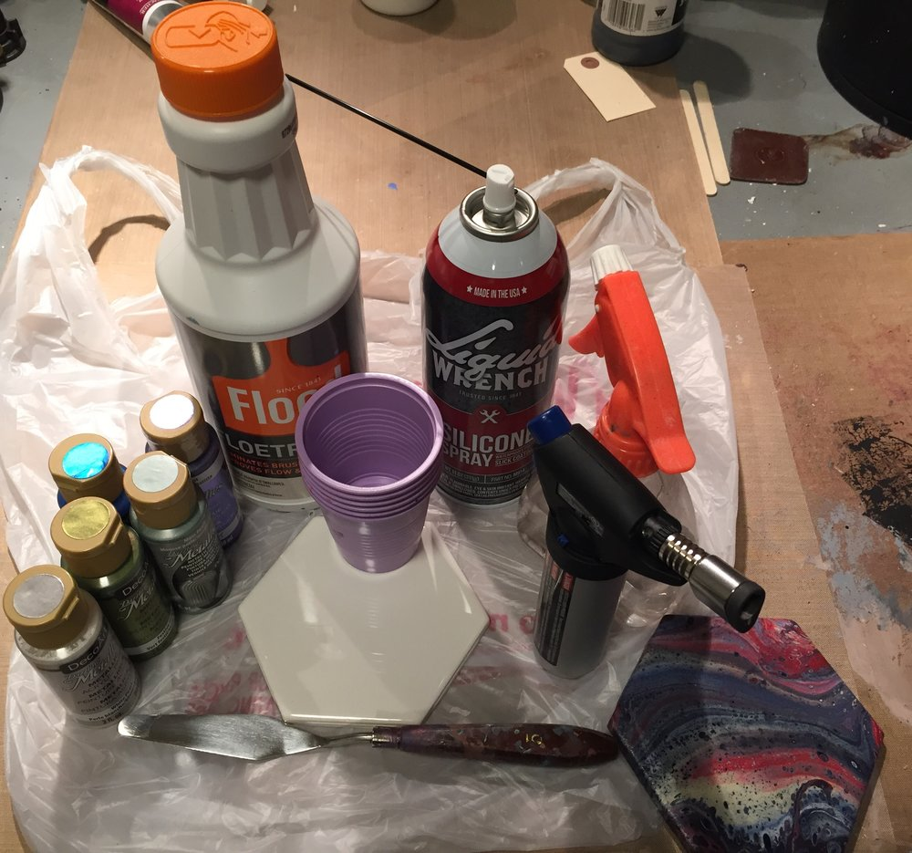 Acrylic Paint, Floetrol paint extender, disposable cups, ceramic tile, palette knife, 100% Silicone, water, torch. You will also need something to protect your work surface, stirring sticks (I use popsicle sticks) and paper towels.  Disposable gloves also are recommended.