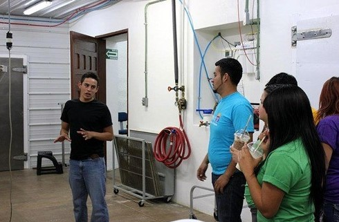 Fede giving a tour of the meat processing plant PCLM to school teachers