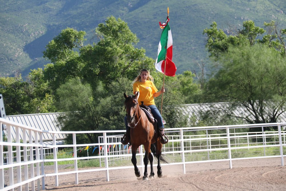 The Presentation of the Mexican flag was brought in on horseback by the Interns who taught the horse riding classes.  The welcome and prayer followed before the competitions began.