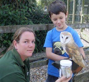 """Spirit the Barn Owl and Liz the falconer say a big """"Thank You"""" to Patrick for his generous donation."""