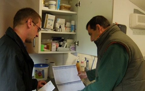 Vet Paul Canham checks the hospital drugs cabinet with Manager Andy Hulm