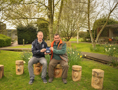 Andy received the award on behalf of S.O.S. on the new carved seats in 'Teachers Corner'