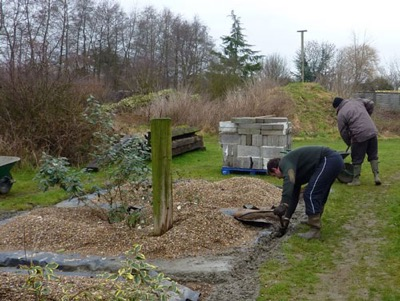 Andy feeds in the last of the concrete footings by hand - phew!