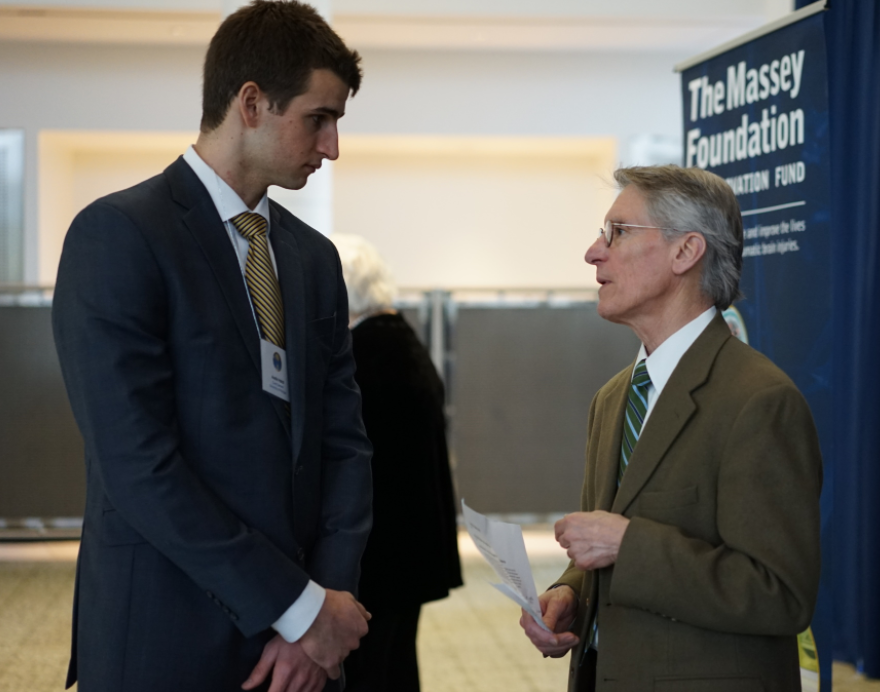 William Barsan, MD, thanks former U-M basketball player Austin Hatch for participating in the Grand Challenge.