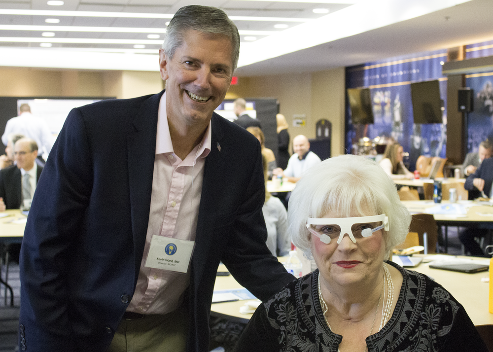 Dr. Kevin Ward (left) with Brenda Massey (right) who is testing the Trans-Ocular Brain Impedance prototype