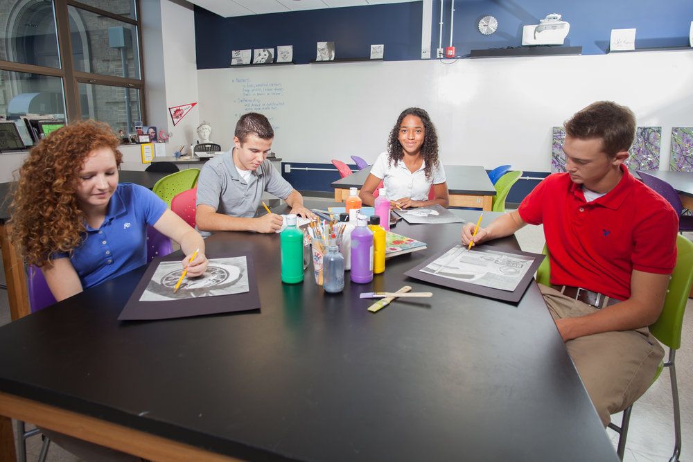 Pictured: Global Impact STEM Academy students working in an art classroom.