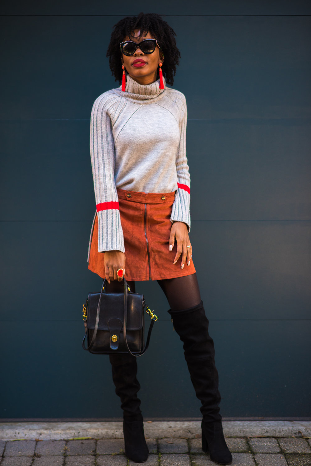 Sweater: Le Tote, Skirt: Forever 21, Boots: Steve Madden; Earrings: Le Tote; Sunglasses: Dolce & Gabbana