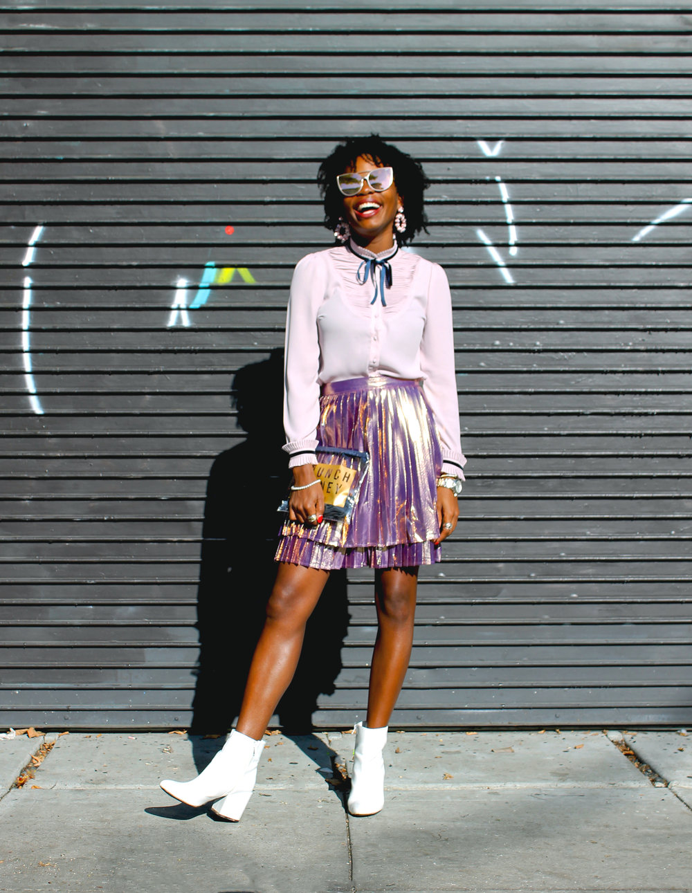 Shirt:  ModCloth ; Skirt:  ModCloth ; Boots: Urban Outfitters; Sunglasses: Quay; Earrings: BaubleBar