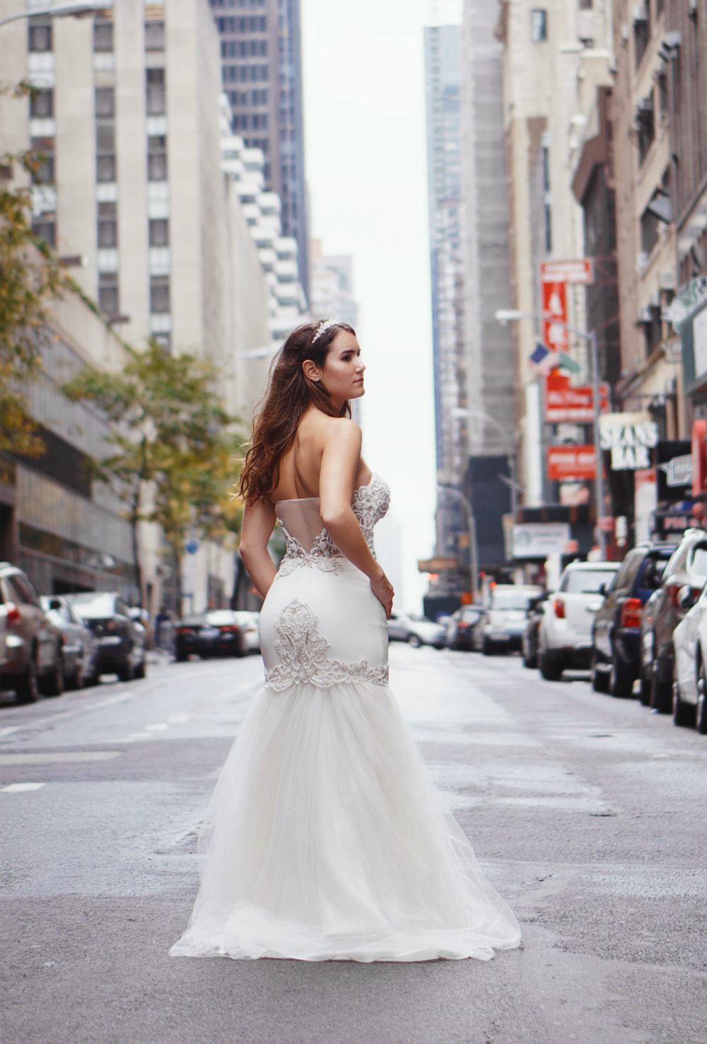 Camille Gown - From the Fall 2018 Collection -Light ivory strapless mermaid gown with full silk flounce. Bustier bodice with diamantes. Featuring an illusion back adorned with beaded threads. Fully lined in silk. Seen here with out Silk tulle overlay and diamante sash which is sold separately.Each dress is made by hand in the USA by our designers. You will love the comfort and support in our gowns structure!