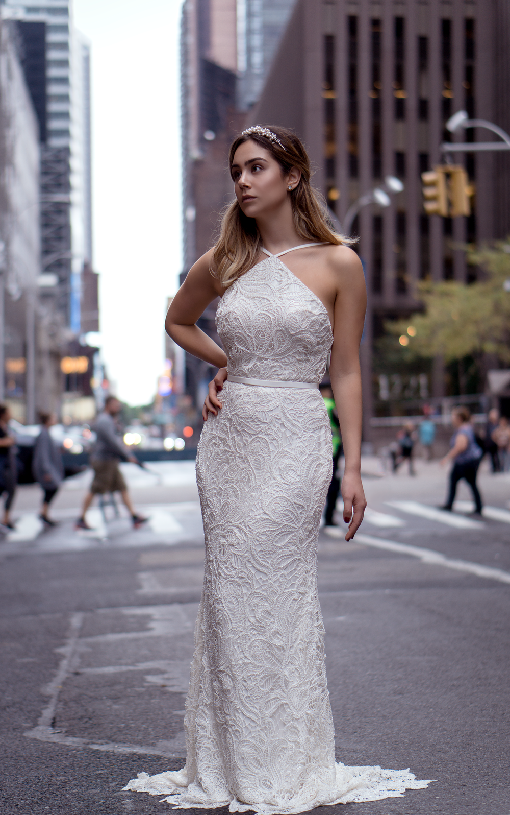 Naomi Gown - From the Fall 2018 Collection - Ivory Halter top lace bridal gown with full beading. Low back-line and fit and flare skirt. Invisible zipper closure. Stylish narrow silk sash  included. Fully lined in silk.Each dress is made by hand in the USA by our designers.  The guipure lace on this gown is Just gorgeous!