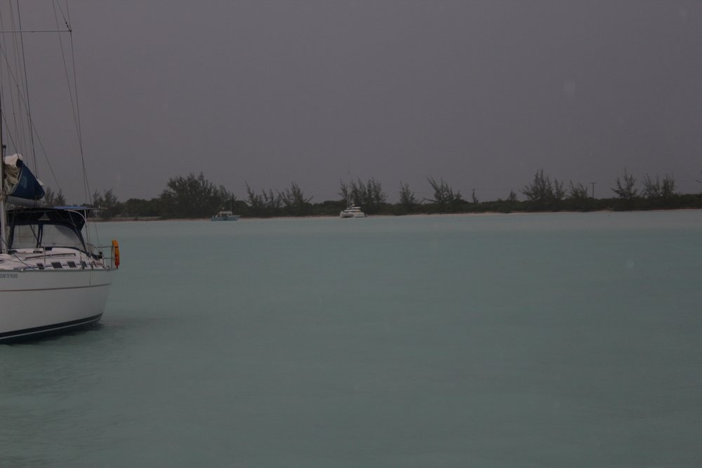 You can barely see the catamaran that beached during the storm, on the shore .
