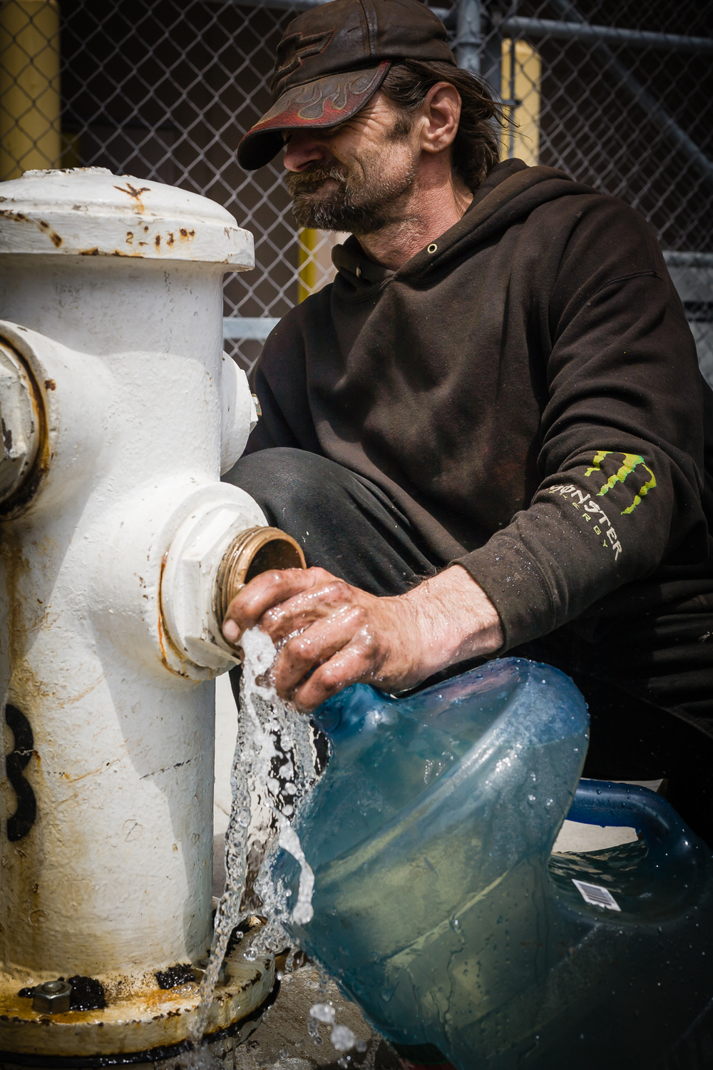 The homeless are extremely resourceful. They have many different water sources depending on the use. Steve taps into the city's water main at a fire hydrant to get water for cooking, and their pets.