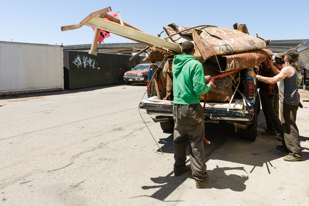 Loading the truck with the collected scrap is a group effort. It must be done quickly and efficiently. The more metal that gets hauled away the more money each person earns at the end of the day.