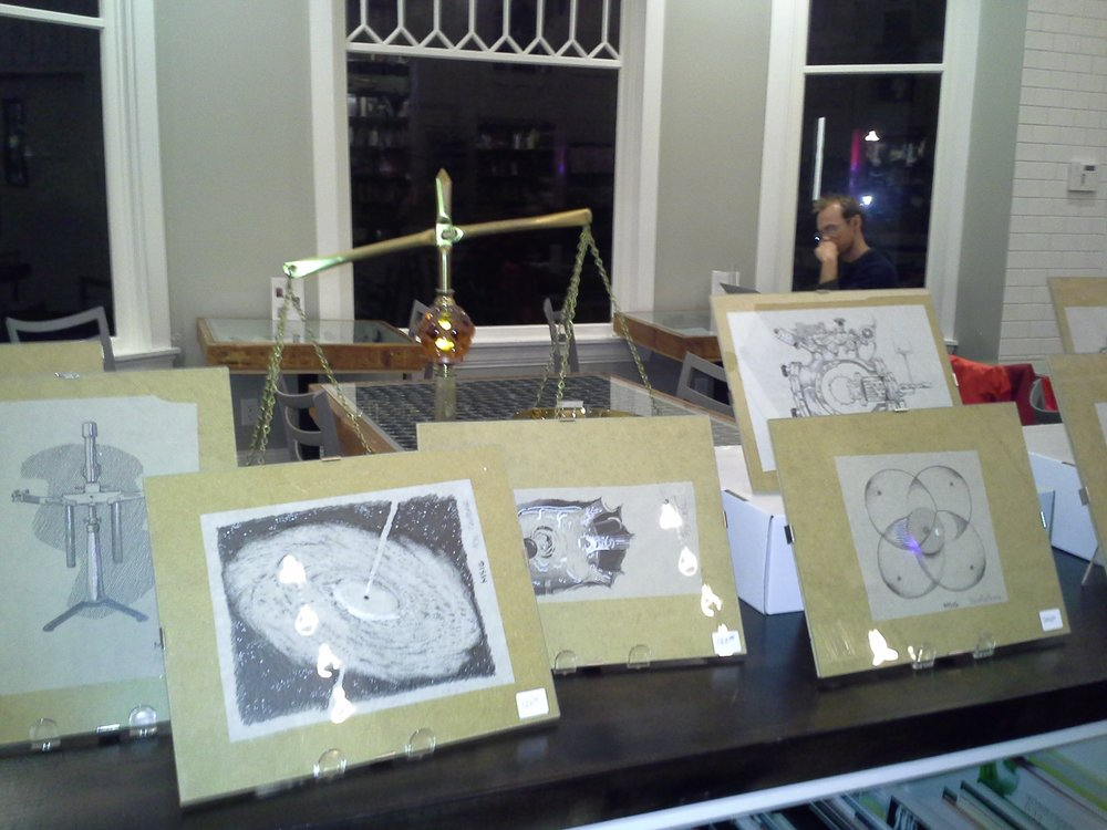 Matt Schmidt's artwork on display at Ada's Books.