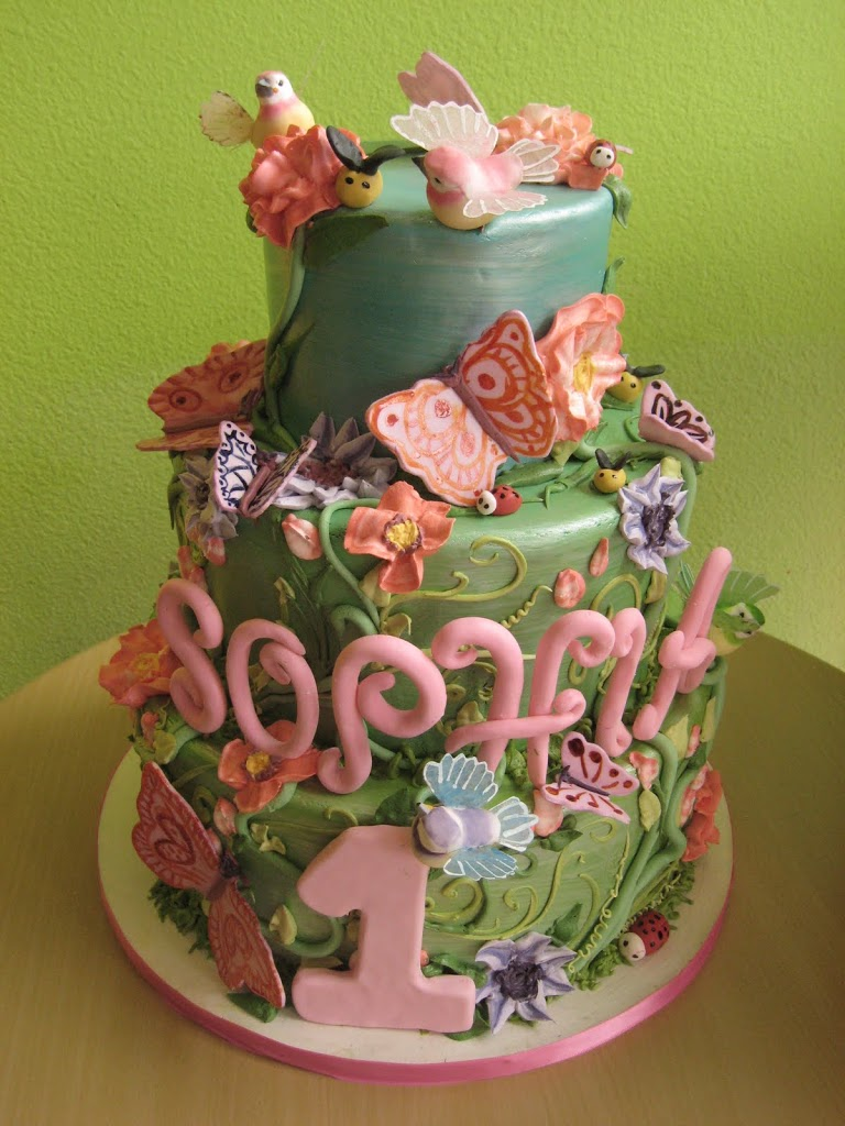 A secret garden birthday cake filled with little ladybugs, bees, butterflies, birds and flowers. So sweet!