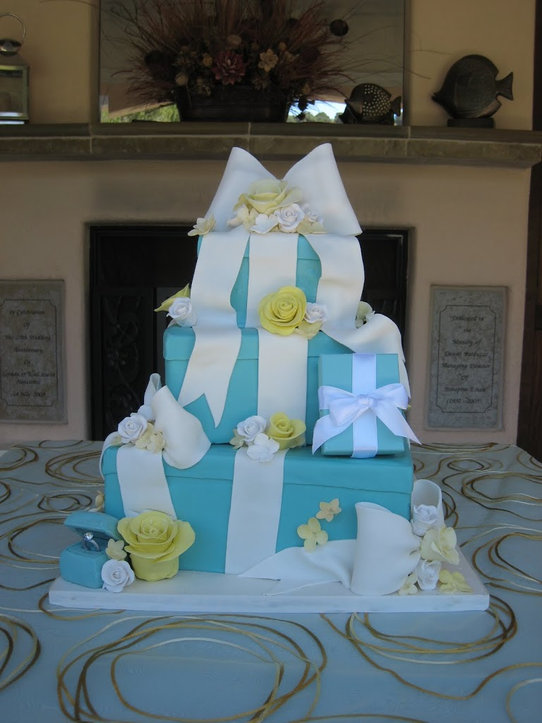 This Tiffany cake had a real box incorporated into the cake for the bride to open. The ring on the bottom was NOT real!