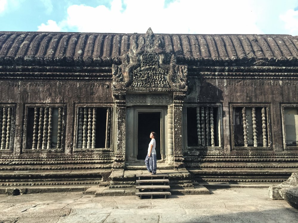 Trying to pose as a Khmer princess inside Angkor Wat.