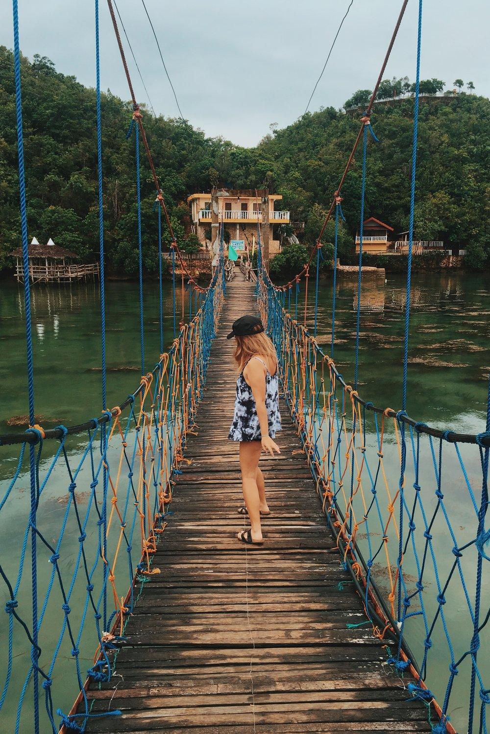 Cross-stepping through this hanging bridge because it is wiggly af.