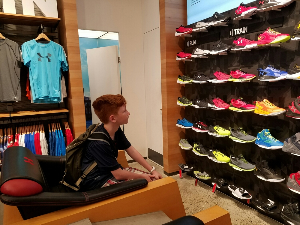 And an Under Armor store featuring Curry's. Milo studies the designs.