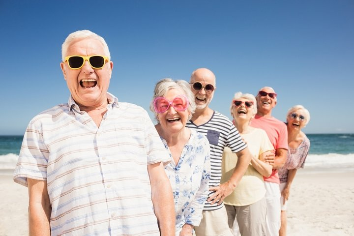 Seniors-Happy-Wearing-Sunglasses-On-Beach.jpg