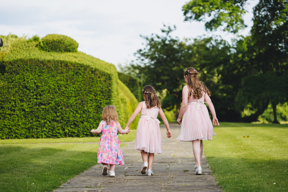 Photos of bridesmaids by south wales wedding photographer. Groom prep