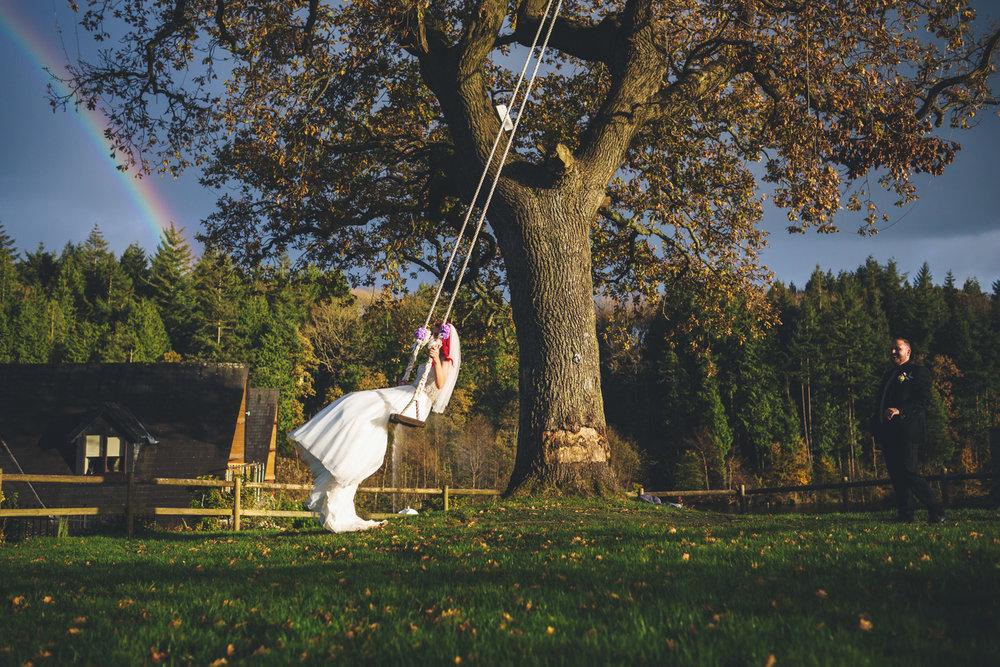 Canada Lake Lodge bride on swing wedding photos