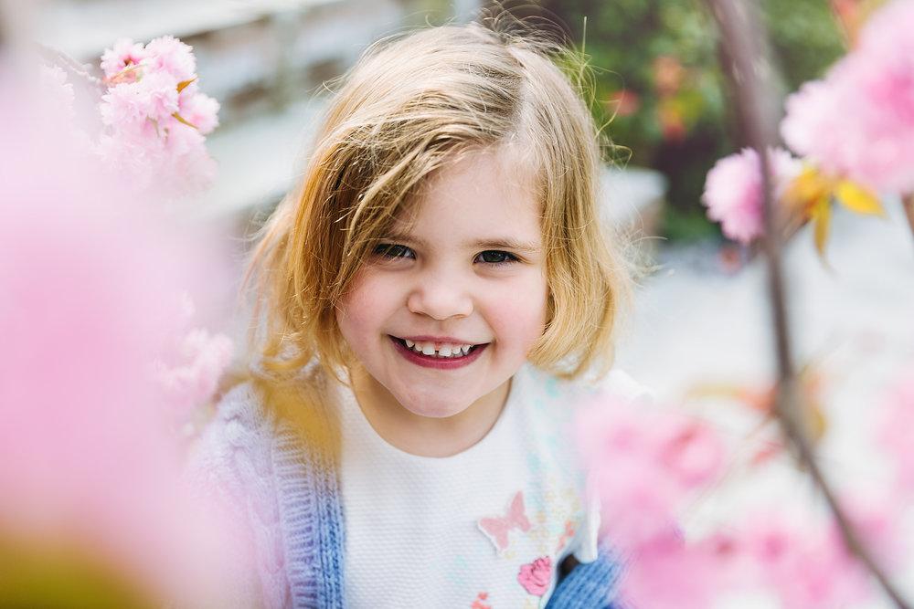 Children's portraits in spring cherry blossom