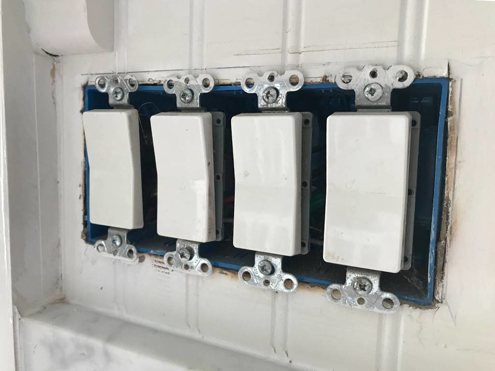 Four switch panel before insulation, with cover removed.