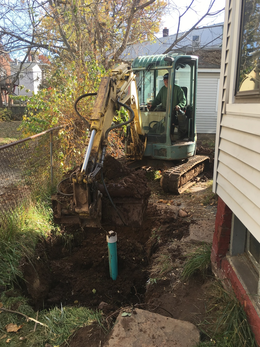 backfilling a newly Installed Sewer line.JPG