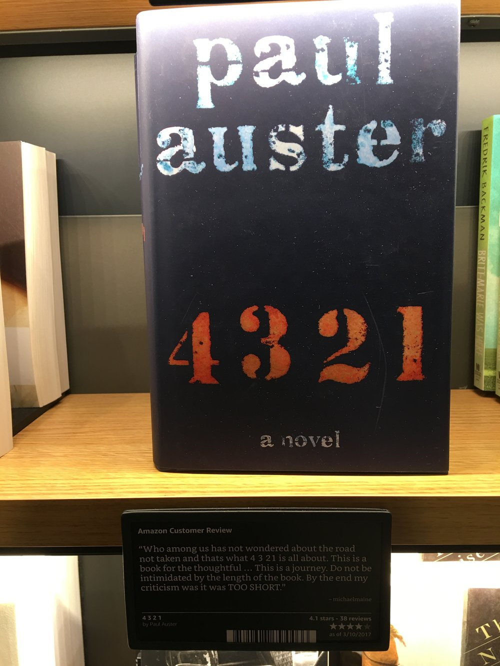 4321 by Paul Auster, and a nice view of the shelf space on display.