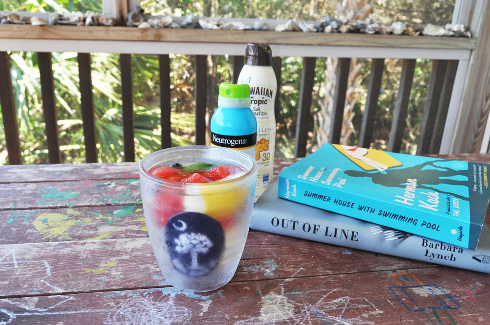 fruity-drink-with-sunscreen-and-books