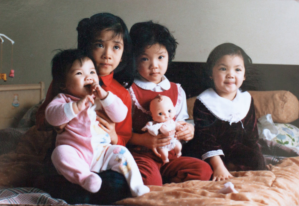 hello! - Welcome. We are the Hua sisters.  We had to post a baby picture because to get us four together in a picture now is so so rare (hopefully we will get to it one day) because we have 10 kids between all of us! Starting from left to right. Janet. The baby and our amazing abstract impressionist painter sister, and mommy to two gorgeous boys! You can find her work here or on her insta here, as well as all over the city in galleries, murals and local shows. If you are interested in any custom work, or a combination of painted, textured art with a photo from our session, just contact us! =)Hurene. The eldest and one of our main photographers on Hua photography and mommy of three amazing kids! She specializes in newborns and babies. Her gentle and calm nature really sets the mood in all of her sessions.  Her photography style beautifully depicts the sweet, tender moments and details of special moments between loved ones. Irene. The second eldest and our photographer on call. She still works as a pharmacist full time and is the mommy of three beautiful girls! Elaine. The 'middle child' and the other main photographer on Hua photography and mommy to two adorable little boys. She specializes in family, couple and editorial.  Unlike Hurene's calm and gentle nature, Elaine is energetic and animated.  Her photography style really captures the energy and interactions between loved ones.