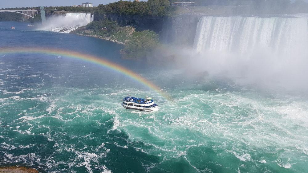 American tour boat (the blue rain jackets).