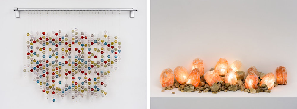 Left: Selfish Idiot (glass version), 2014, blown glass, monofilament, metal rod 46 x 35 x 3 inches Right: What, 2014, carved salt crystals, river rocks, electrical wiring, dimensions variable (shown: 54 x 18 x 14 inches)