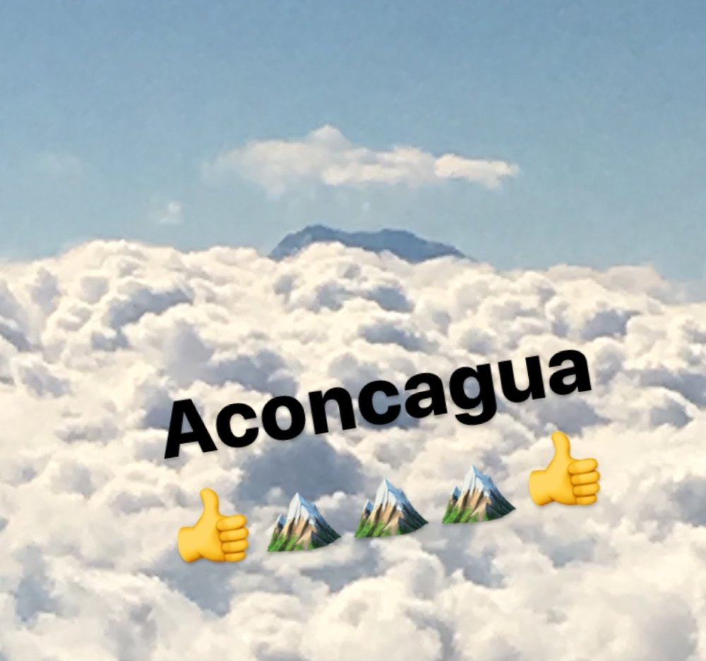 Grainy iPhone snap from the approach to Santiago de Chile: Aconcagua with her very own crown of clouds